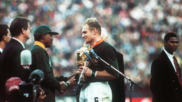 Francois Pienaar receives the Webb Ellis Cup from Nelson Mandela after the 1995 RWC final. Photograph: Inpho/AllSport