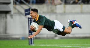 Herschel Jantjies scores his match-saving try for the Springboks against the All Blacks. Photograph: Mark Tantrum/Getty