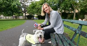 Rachel Waite, originally from Wisconsin, USA, with her dog Rooney. Photograph: Dave Meehan for The Irish Times