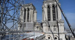 Scaffolding is seen during preliminary work on top of the Notre-Dame de Paris Cathedral three months after a major fire. Photograph: Getty Images