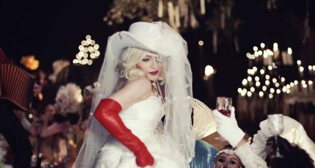 Madonna wears gloves by Irish designer Paula Rowan.