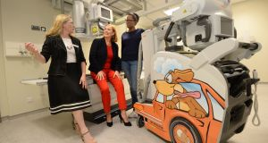 Dr Ciara Martin and  Eilísh Hardiman of Children's Health Ireland and radiographer Dineo Hunters at the children's urgent care centre at Connolly Hospital. Photograph: Dara Mac Dónaill