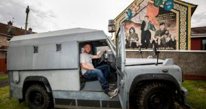 Stephen Corbett  in the driver seat of a former RUC Land Rover bought by his brother Art Corbett. Photograph: Liam McBurney/PA Wire