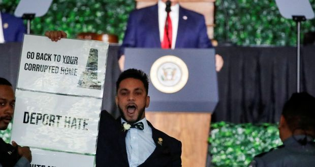 Democrat Ibraheem Samirah interrupts President Donald Trump as he speaks at an event in Jamestown, Virginia to mark  the 400th anniversary of the founding of the colony by British settlers in 1619. Photograph: Carlos Barria/Reuters