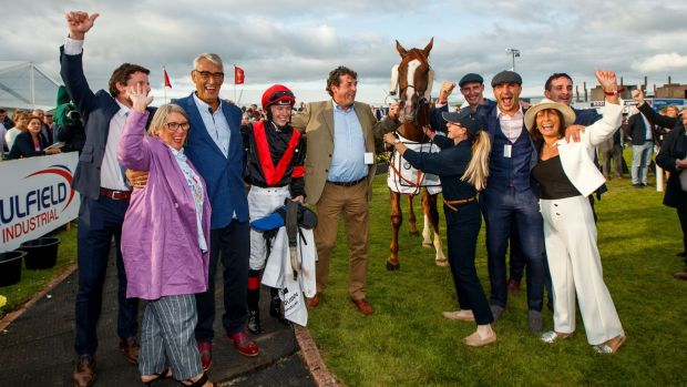 Jockey Colin Keane and trainer Adrian McGuinness with Saltonstall and winning connections. Photograph: James Crombie/Inpho