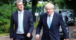 Britain's Northern Ireland secretary Julian Smith (left) and Britain's prime minister Boris Johnson arrive at Stormont House, Belfast for talks on Wednesday. Photograph: AFP/Getty