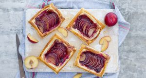 Plums in puff pastry. Photograph: Harry Weir Photography