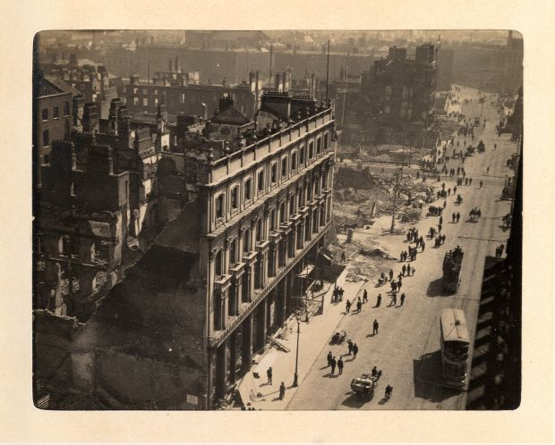 O'Connell Street during the 1916 Rising, with Trinity College in the background. Photograph: The Board of Trinity College Dublin.