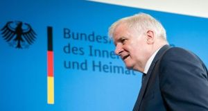 German interior minister Horst Seehofer, struggling to hold back tears on Tuesday, promised to keep perspective in serious, populist times. Photograph: Getty