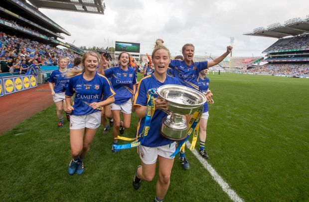 Tipperary's Samantha Lambert lifts the All-Ireland Intermediate football cup in 2017 in Croke Park. Photograph: Morgan Treacy/Inpho