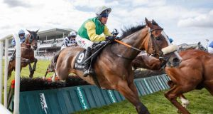 Robbie Power on Tudor City in action during the the Guinness Galway Hurdle Handicap. Photograph: James Crombie