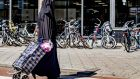 A woman wearing Islamic dress in Rotterdam: along with  Amsterdam and Utrecht, the city plans to ignore application of the burka ban. Photograph: Robin Utrecht