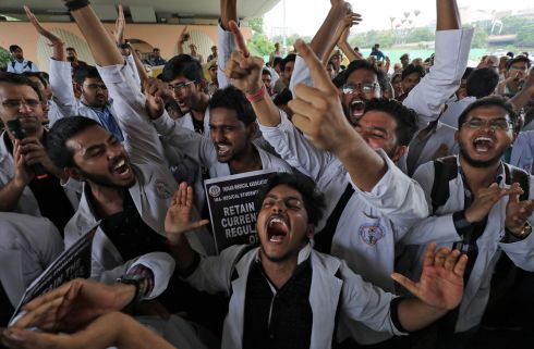Medical students protest against the National Medical Commission Bill, which they say will result in the deterioration of medical studies and services, in New Delhi, India. Photograph: Anushree Fadnavis/Reuters