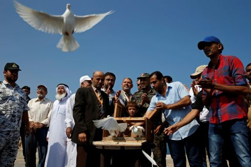 The release of pigeons during a homing pigeon racing in Gaza City, Palestine. Photograph: Mohammed Salem/Reuters