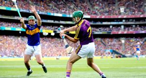 Shaun Murphy: the rampaging runs forward by Wexford defenders posed Tipperary problems during the entertaining first half at Croke Park. Photograph: Ryan Byrne/Inpho