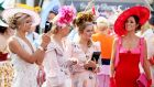 Glitz and glam: hopefuls attend Ladies Day at the Galway Races. Photograph: Brian Lawless/PA Wire