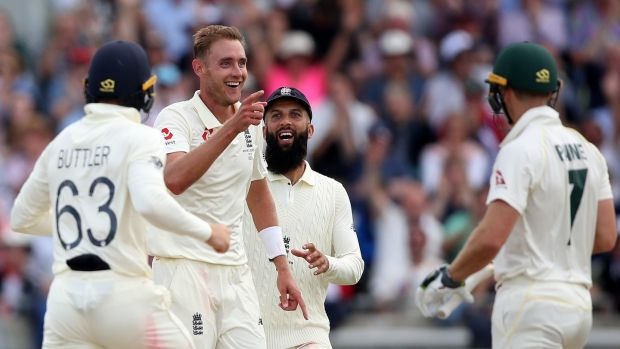 England's Stuart Broad celebrates taking the wicket of Australia's Tim Paine. Photograph: Nick Potts/PA Wire.