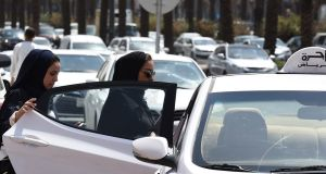 Saudi women get into a taxi  in the Saudi capital Riyadh. Photograph: Fayez Nureldine/AFP/Getty Images