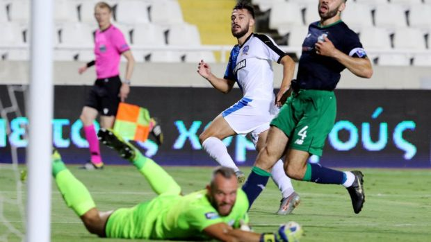 Apollon's Adrian Sardinero scores the winning goal past Rovers' goalkeeper Alan Mannus. Photograph: Chara Savvides/Inpho