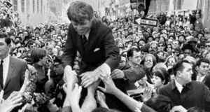 Robert Kennedy  shakes hands with people in a crowd while campaigning for the Democratic party's presidential nomination on a street corner, in Philadelphia.   Photograph: Warren Winterbottom