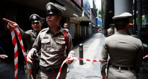 Thai police officers secure the area after a suspicious object was found, on Silom road in Bangkok on Friday. Photograph: EPA