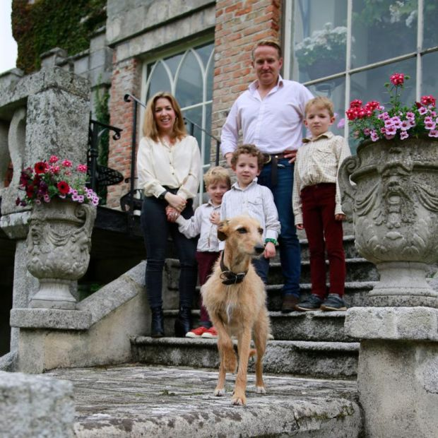 Huntington Castle: Clare and Alex Durdin Robertson with their children, five-year-old Freddie, seven-year-old Esmonde and eight-year-old Herbert, with their dog Myrtle. Photograph: Nick Bradshaw