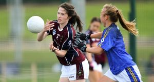 Ciara Hession of St Colmcilles, Britain (left)  in action against Europe Eagles in their Ladies Football Native Born tournament game. Photograph:  Piaras Ó Mídheach/Sportsfile