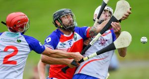 Jeffrey Ryan Gravley from Mid-Atlantic in action against Chad Nelson (left) and John Kenney of Heartland in their Hurling Native Born tournament game this week.  Photograph: Piaras Ó Mídheach/Sportsfile