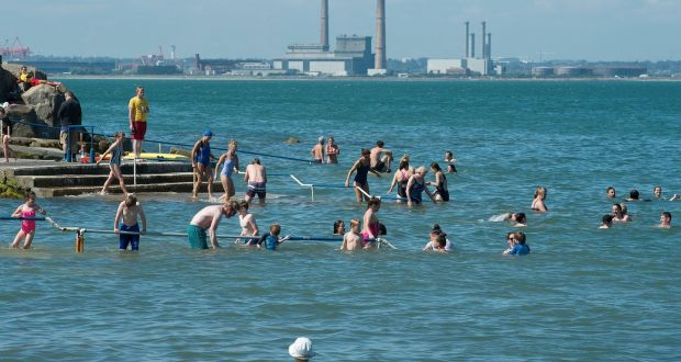Swimmers enjoy the sunshine at Seapoint in Dublin. The August bank holiday will start off dry and sunny but will turn wet on Monday with the possibility of torrential rain and spot flooding.  Photograph: Dave Meehan/The Irish Times.