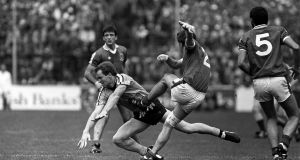 Mayo's Martin Carney is blocked down by Dublin's Barney Rock during the 1985 All-Ireland semi-final replay. Photograph: Inpho