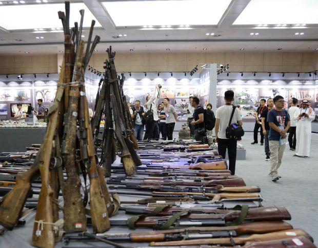 A display of seized arms at an exhibition about recent terror attacks in Xinjiang. Photograph: Peter Goff