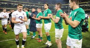 Johnny Sexton claps England's Owen Farrell off the pitch following the home defeat in the Six Nations which inflicted significant psychological damage on Ireland. Photograph: Billy Stickland/Inpho