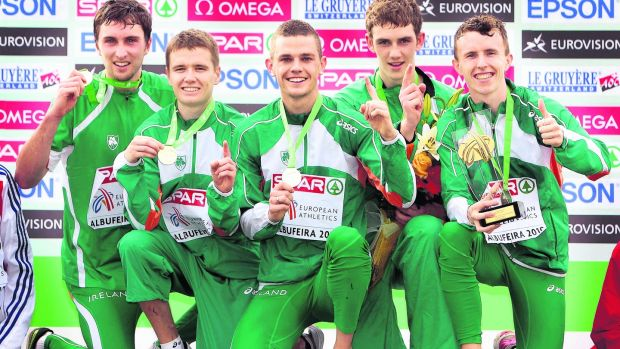 The Irish Men's U23 team of, John Coghlan, David Rooney. David McCarthy, Michael Mulhare and Brendan O'Neill (missing, Ciaran O'Lionaird) celebrate winning gold in the European Cross Country Championships at Albufeira, Portugal in 2010. Photograph: Morgan Treacy/Inpho