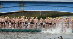 Participants line up for the 100th Liffey Swim. Photograph: Dara Mac Donaill / The Irish Times