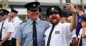 A member of the PSNI and  Garda take a selfie together at the start of the Belfast Pride parade. Photograph: Niall Carson/PA Wire