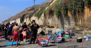 Emergency responders at the cliff collapse in Encinitas, California. Photograph: Paul Ecke/Reuters