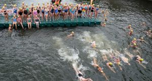 The women get started in The 100th Liffey Swim, which took place in Dublin today. The historic race over 2.2km on the capital's waterway attracted several hundred entrants for both the men's and women's races. Photograph: Dave Meehan