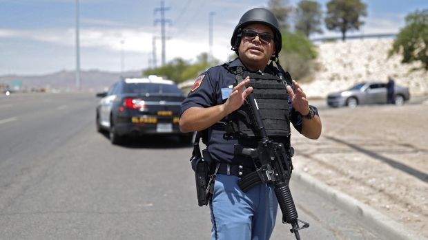 A police officer outside the mall, where an active shooter situation is ongoing. Photogprah: Ivan Pierre Aguirre/EPA