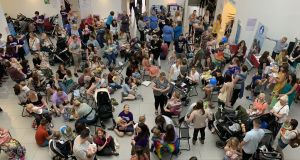 Some 611 people were at the Big Latch On at the Ulster Museum, where 236 mothers provided milk for 237 children at the same time.  Photograph: Amanda Ferguson