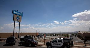 Law enforcement near a Walmart in El Paso, Texas, where a mass shooting took place. Photogaph: Adriana Zehbrauskas/The New York Time