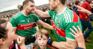 Mayo's Aidan O'Shea and Chris Barrett celebrate after the victory over Mayo in Castlebar. Photograph: James Crombie/Inpho