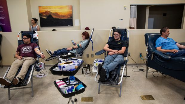 People donate blood at a blood bank in El Paso, Texas. Photograph: Adriana Zehbrauskas/The New York Times