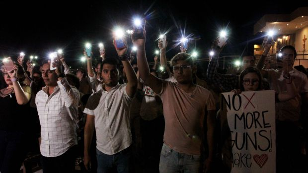 People hold their mobile phones with flash on during a vigil in Ciudad Juarez, which lies just over the border from El Paso in Mexico. Photograph: Herika Martinez/AFP/Getty Images
