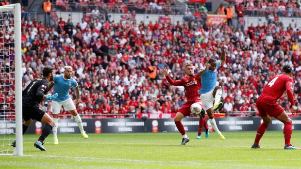 Raheem Sterling opens the scoring for Man City against Liverpool. Photograph: David Klein/Reuters
