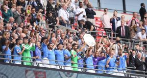 Man City celebrate their Community Shield win. Photograph: Laurence Griffiths/Getty