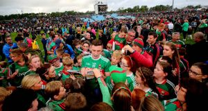 Mayo's Fionn McDonagh surrounded by delighted fans following the victory over Donegal at MacHale Park. Photograph: Ryan Byrne/Inpho