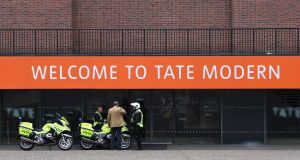 Police officers  outside the Tate Modern gallery in London after an incident involving a child falling from height and being airlifted to hospital. Photograph: Daniel Sorabji/AFP/Getty Images