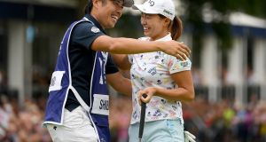 Hinako Shibuno of Japan and her caddie celebrate after the final round of the AIG Women's British Open at Woburn. Photograph: Ross Kinnaird/Getty Images