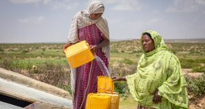 Sahra Mohamed and Marya Abdulah get drinking water from the Concern and Echo-funded water catchment tank in northern Somaliland. Photograph: Gavin Douglas/ Concern Worldwide