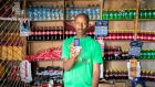 In the village of Jir Jir in Somaliland, shopkeeper Roble Barkad accepts cashless payments confirmed by text. Photograph: Gavin Douglas